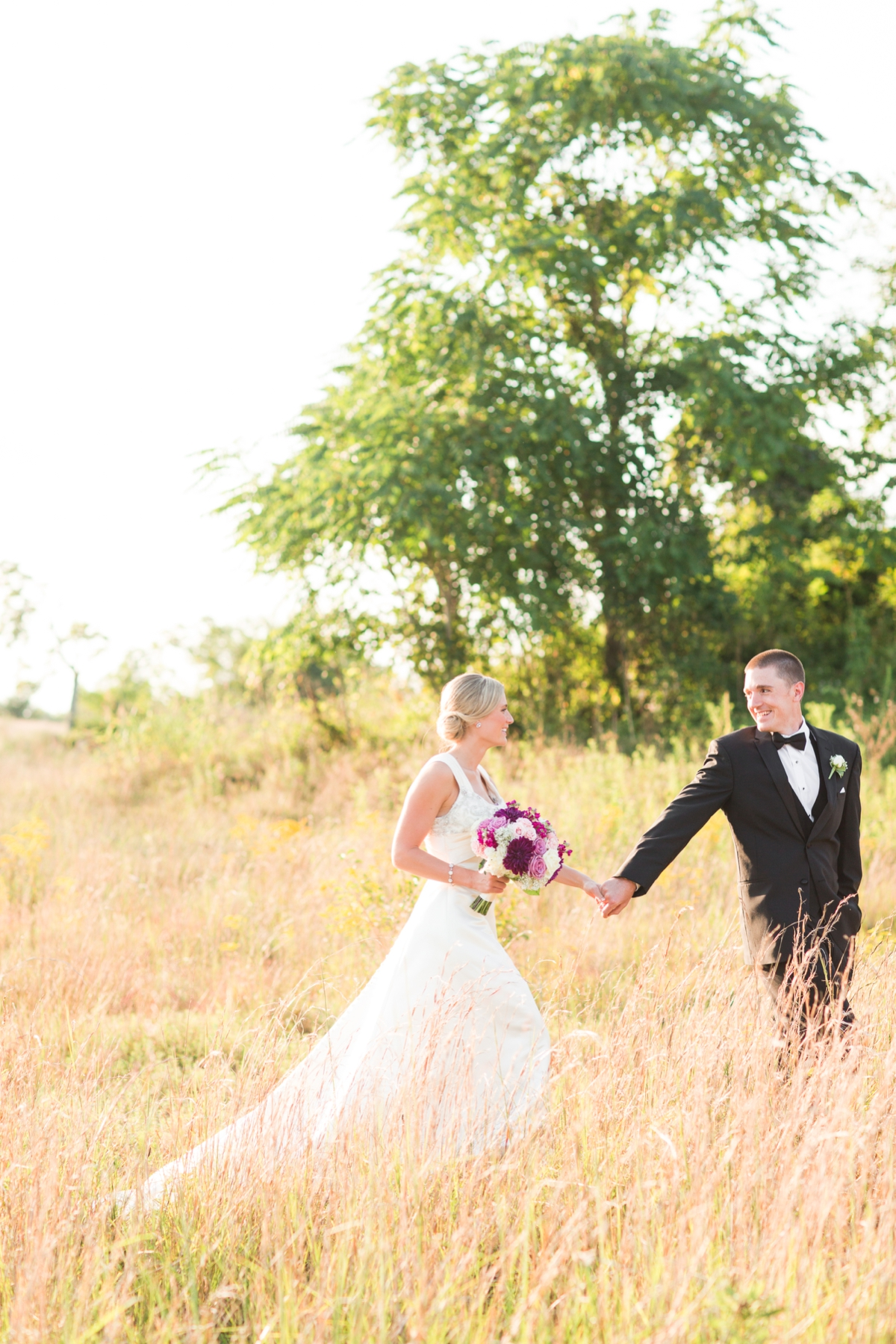 Bride and Groom Field Portraits with evening glowy light. Riverside On the Potomac Barn Wedding Photos. DC Barn Wedding. DC Farm Wedding. Outdoor Ceremony, Indoor Reception.