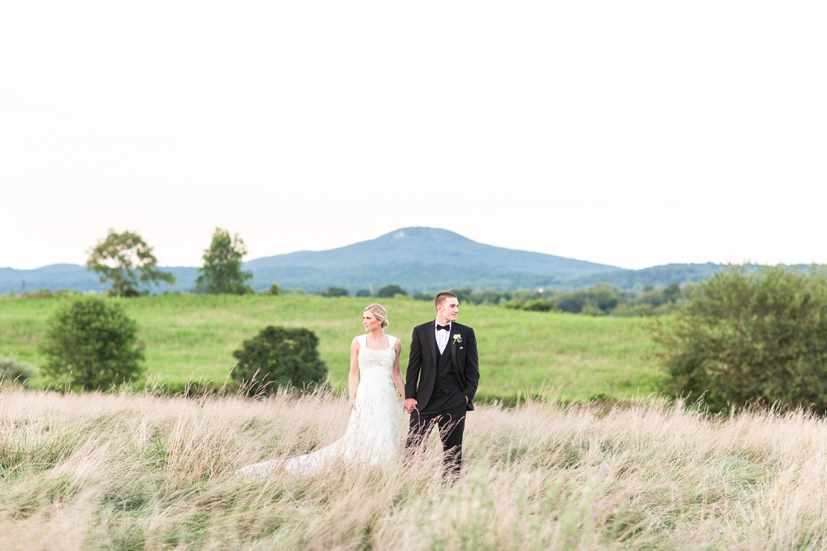 Riverside On the Potomac Barn Wedding Photos. Bride and Groom Portraits in an open field