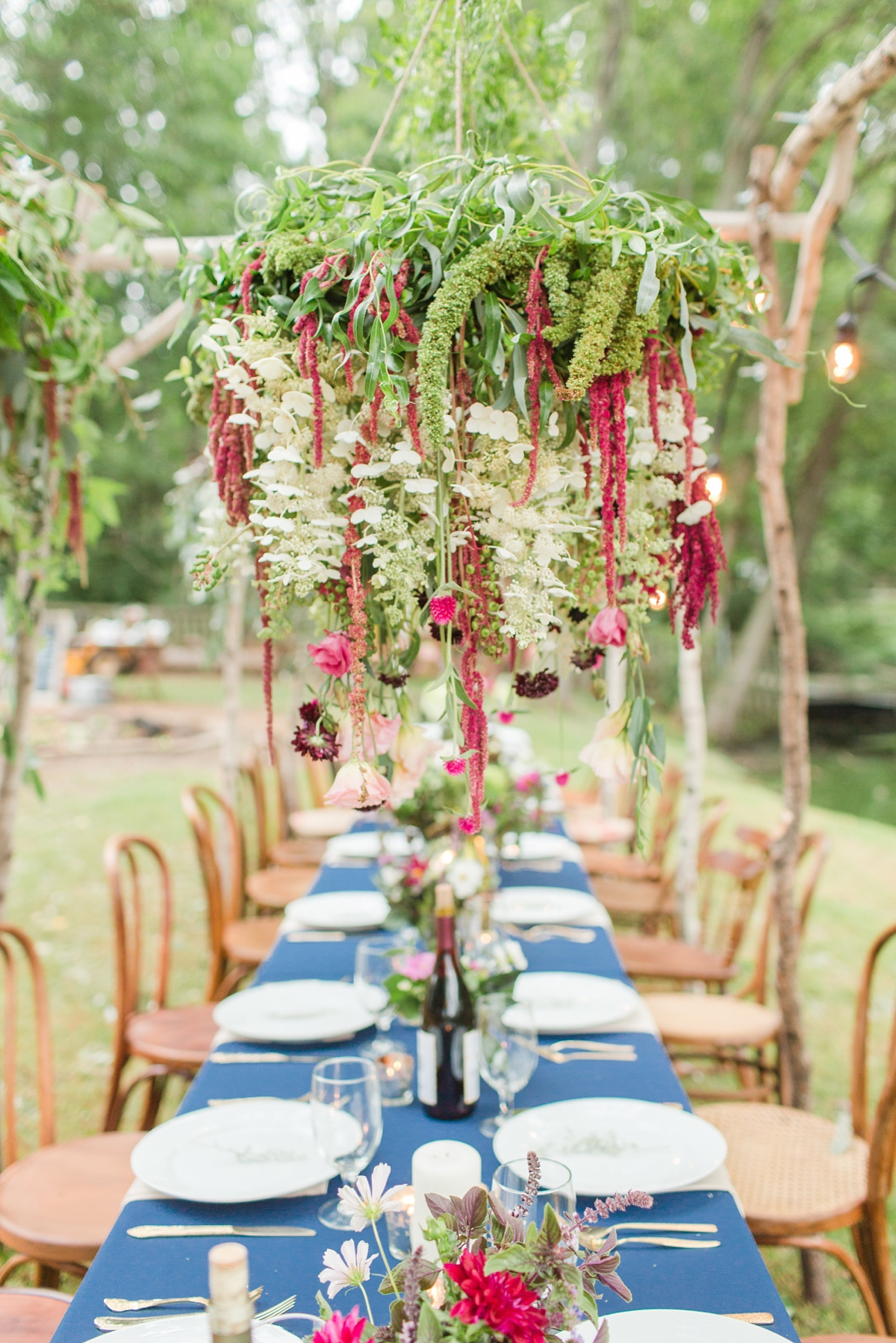 outdoor dinner under the stars with floral chandelier_5659