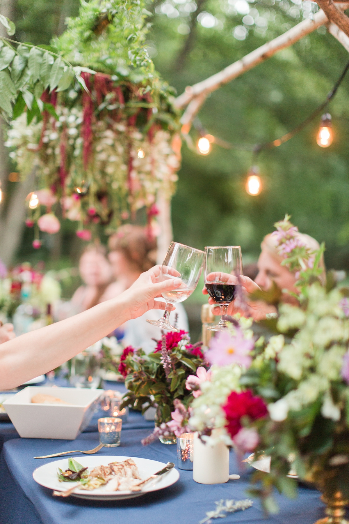 outdoor dinner under the stars with floral chandelier_5671
