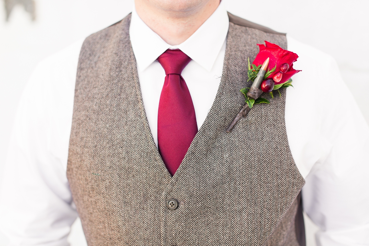 Cranberry Tie with Heathered Brown Vest and Cranberry Boutonniere. A Rustic Brandy Hill Farm Wedding in Culpeper, Virginia featuring accents of cranberry and gold! Photos by Katelyn James Photography