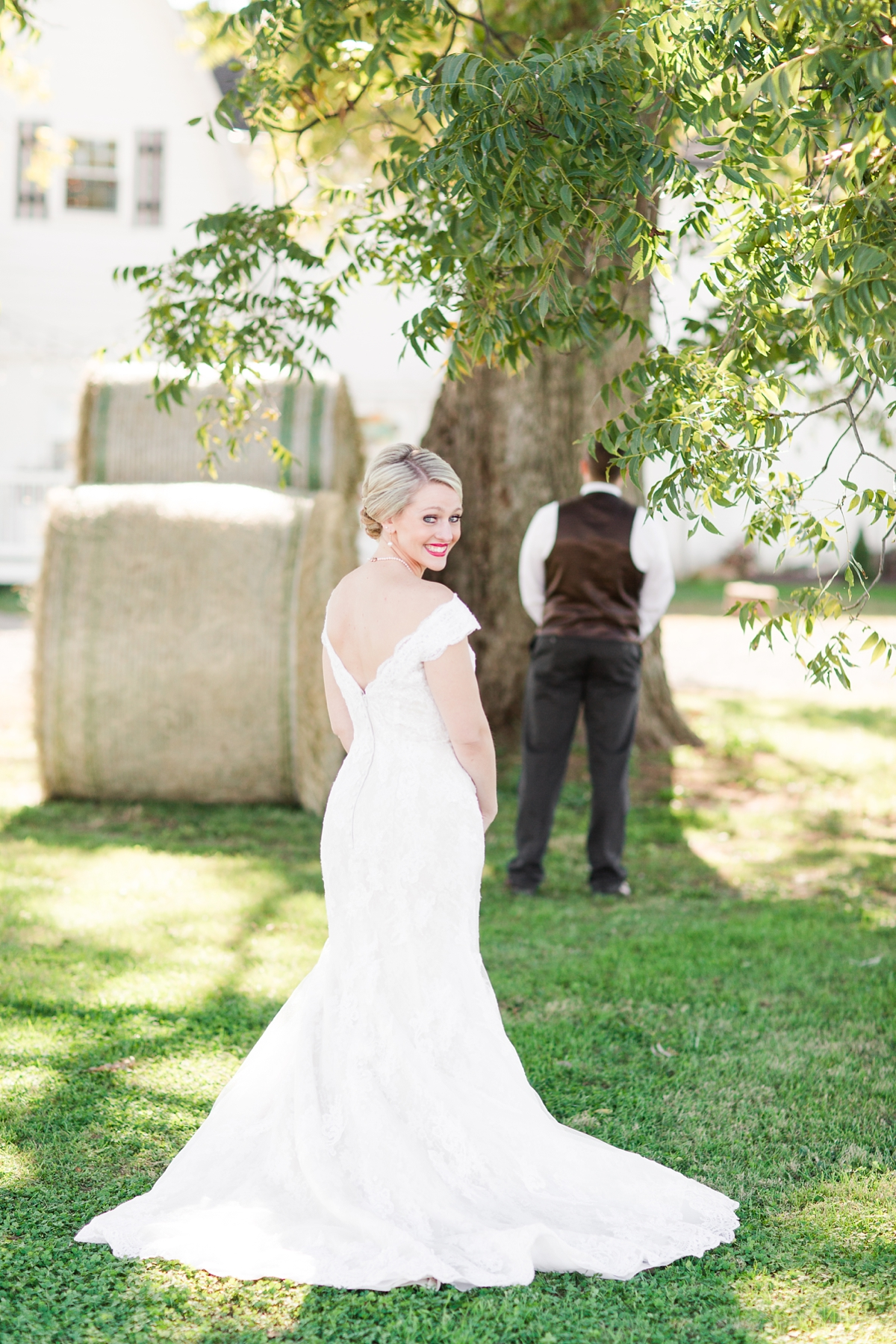 A Rustic Brandy Hill Farm First Look with Hay Bales in Culpeper, Virginia featuring accents of cranberry and gold! Photos by Katelyn James Photography