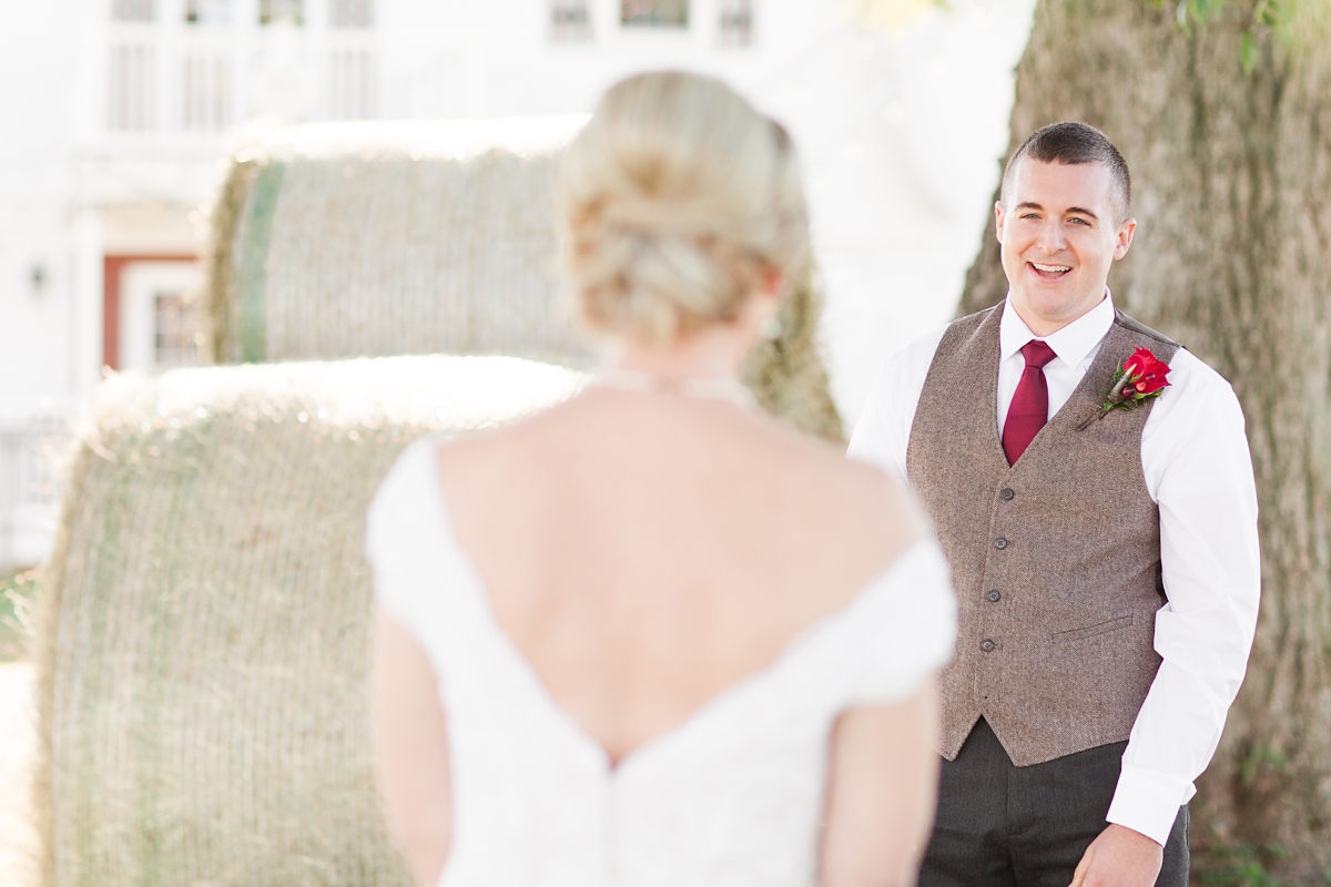 Groom's joy during the first look when he sees his bride!! A Rustic Brandy Hill Farm Wedding in Culpeper, Virginia featuring accents of cranberry and gold! Photos by Katelyn James Photography