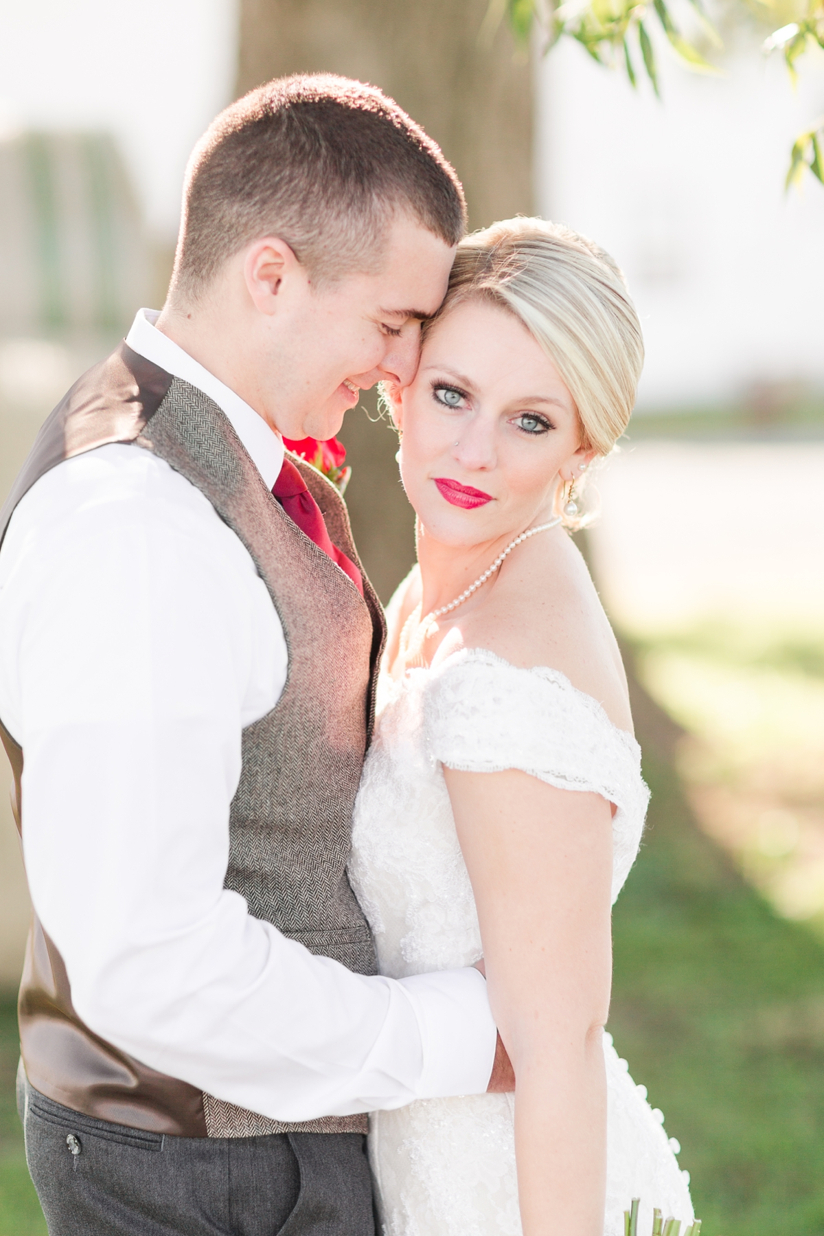 Bride and Groom Model Face Portraits with a pop of red lipstick and cranberry tie!  A Rustic Brandy Hill Farm Wedding in Culpeper, Virginia featuring accents of cranberry and gold! Photos by Katelyn James Photography