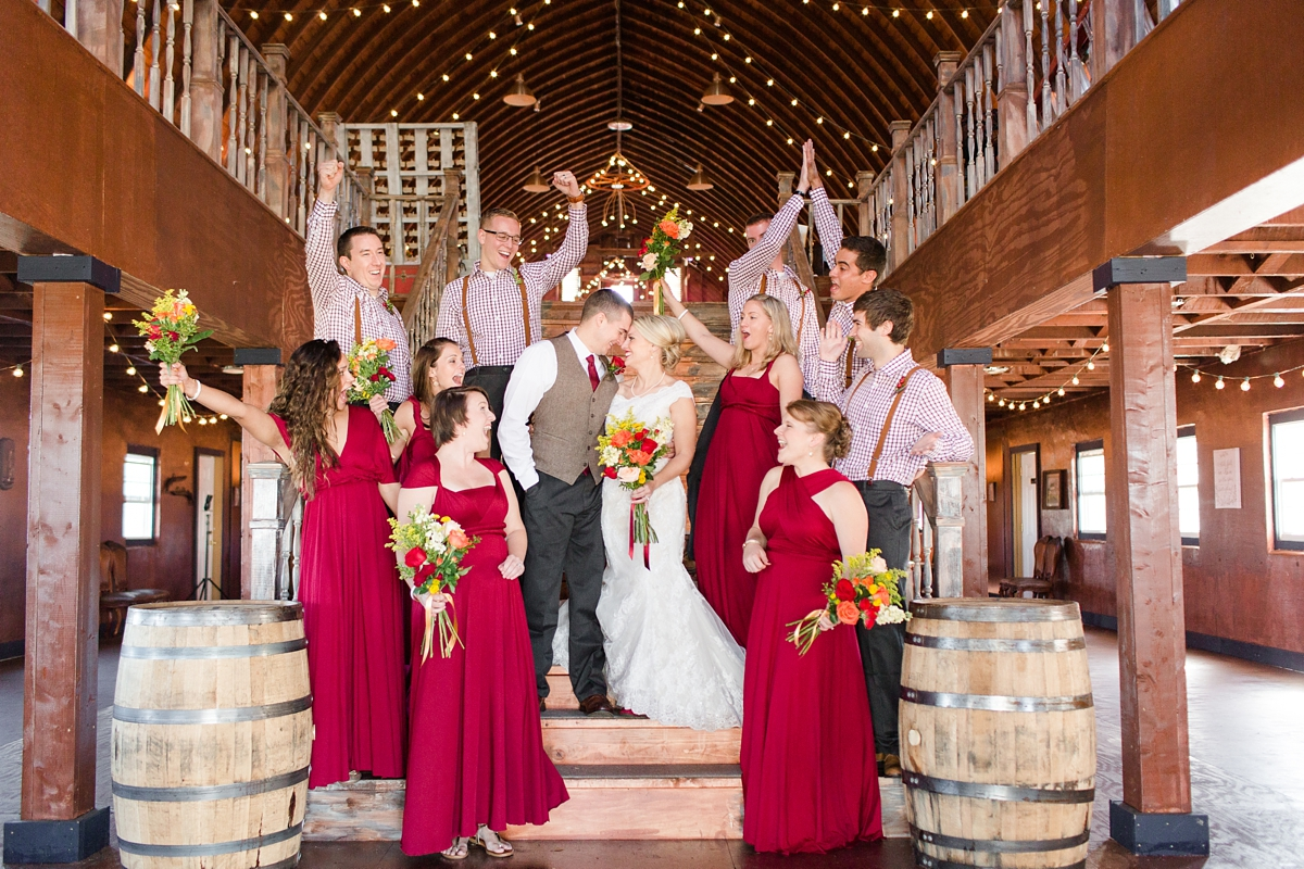 A Rustic Brandy Hill Farm Wedding in Culpeper, Virginia featuring accents of cranberry and gold in florals and bridal party attire! Photos by Katelyn James Photography