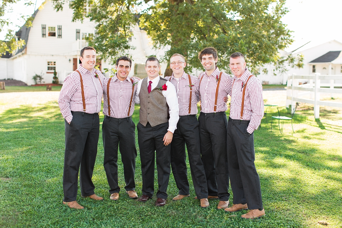 Groomsmen checkered cranberry shirt with cranberry suspenders. A Rustic Brandy Hill Farm Wedding in Culpeper, Virginia featuring accents of cranberry and gold! Photos by Katelyn James Photography