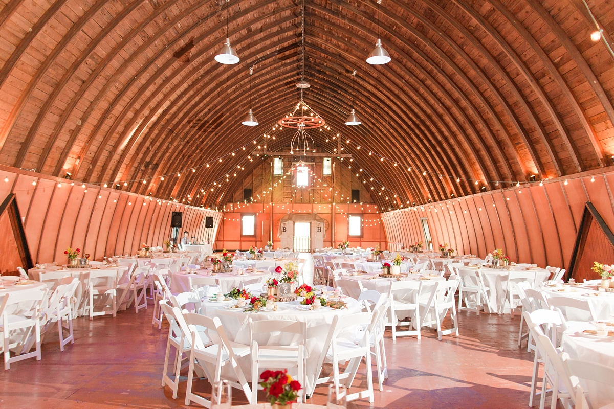 Ceremony turned into Reception. Large High Ceiling Barn Wedding Reception with Sting Lights. A Rustic Brandy Hill Farm Wedding in Culpeper, Virginia featuring accents of cranberry and gold! Photos by Katelyn James Photography