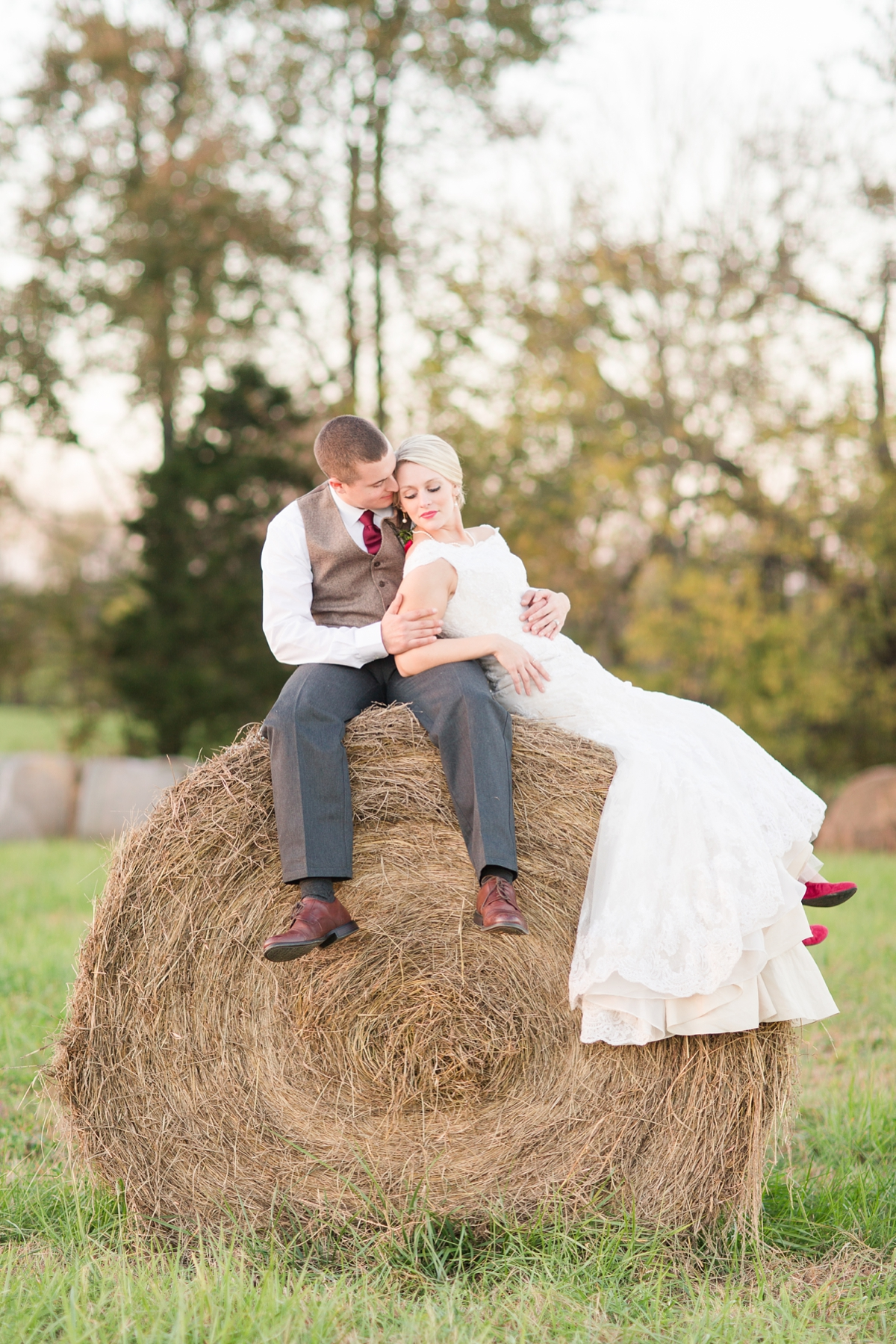 Evening Glow Bride and Groom Hay Bale Portraits. A Rustic Brandy Hill Farm Wedding in Culpeper, Virginia featuring accents of cranberry and gold! Photos by Katelyn James Photography