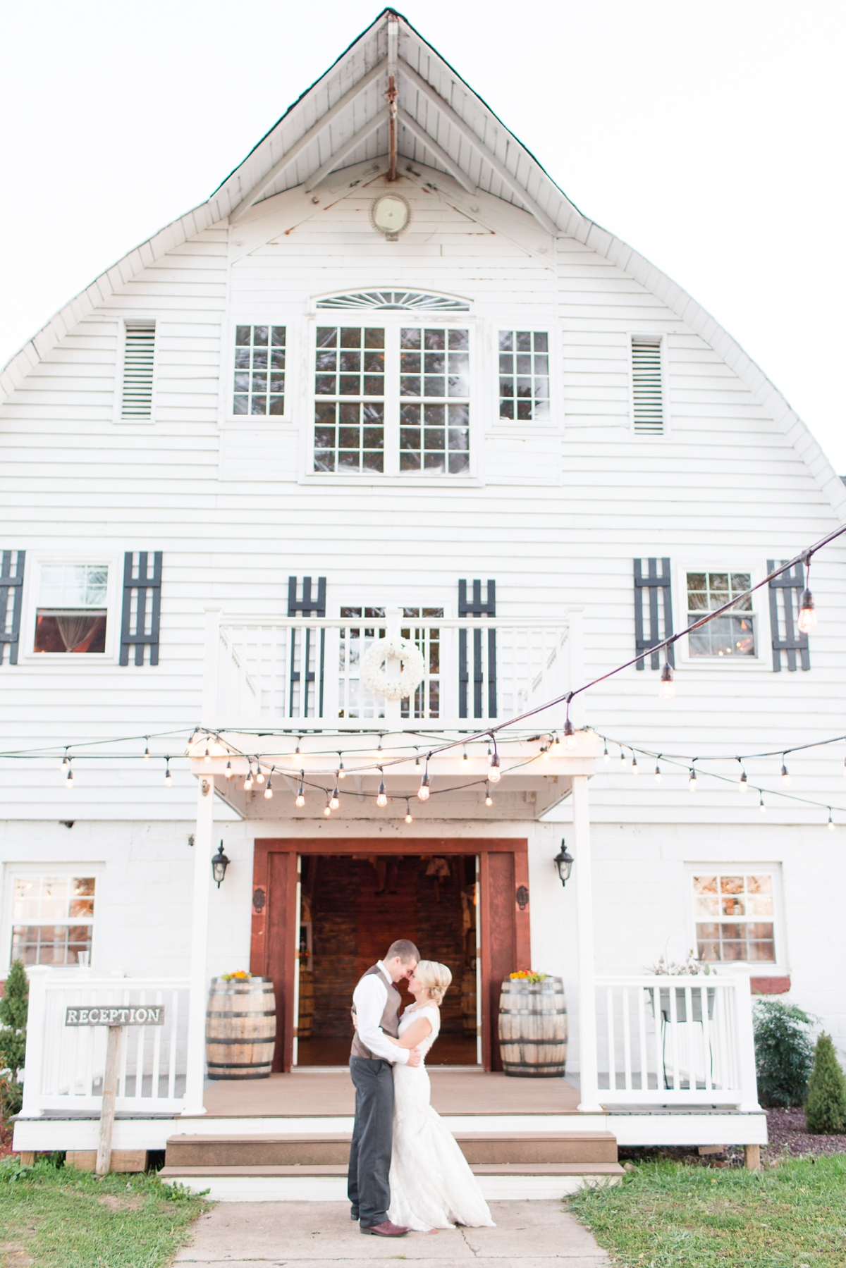 Bride and Groom Full Barn Portrait during Reception. A Rustic Brandy Hill Farm Wedding in Culpeper, Virginia featuring accents of cranberry and gold! Photos by Katelyn James Photography
