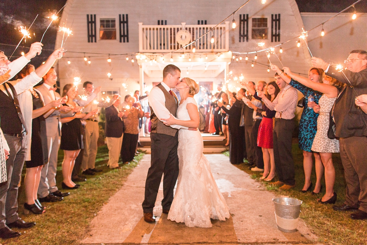 Sparkler Wedding Reception Exit in Front of Gorgeous Barn. A Rustic Brandy Hill Farm Wedding in Culpeper, Virginia featuring accents of cranberry and gold! Photos by Katelyn James Photography