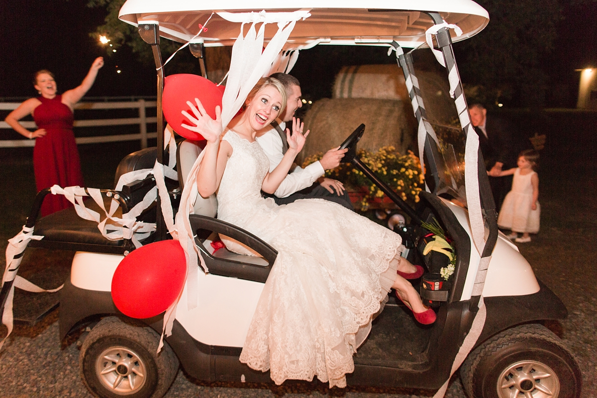 Bride and Groom Wedding Exit by Golf Cart!! A Rustic Brandy Hill Farm Wedding in Culpeper, Virginia featuring accents of cranberry and gold! Photos by Katelyn James Photography
